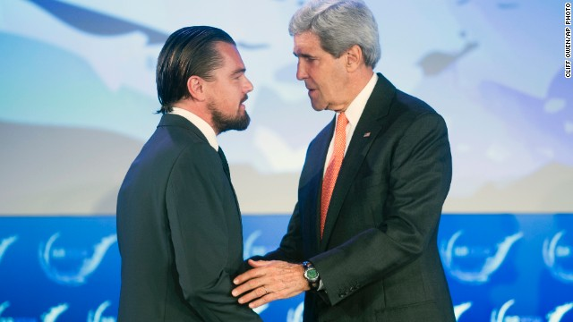 Secretary of State John Kerry talks with actor Leonardo DiCaprio after they both spoke at the second day of the State Department's 'Our Ocean' conference in Washington.