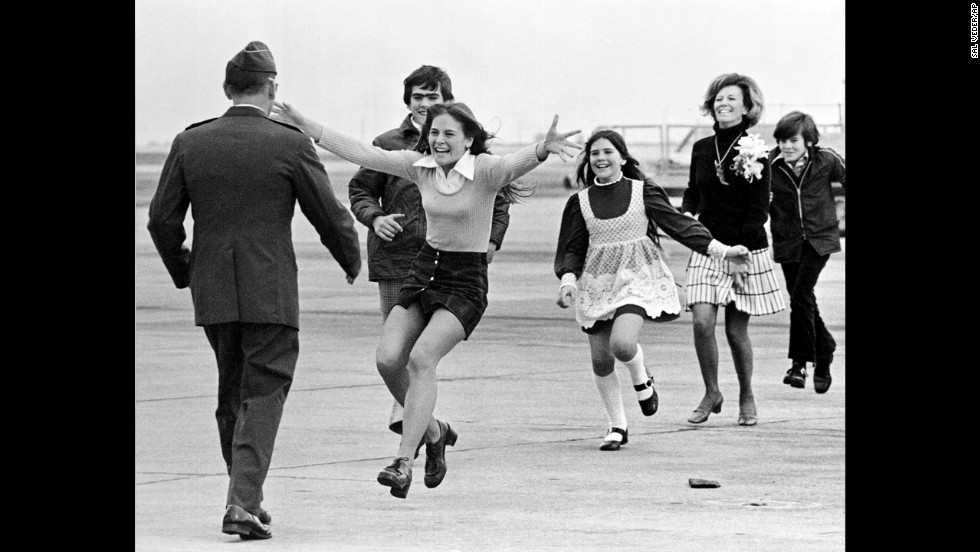 "Newly freed U.S. prisoner of war  Air Force Lt. Col. Robert L. Stirm is greeted by his family at Travis Air Force Base in Fairfield, California, in 1973. This Pulitzer Prize-winning photograph, named Burst of Joy, was taken by Associated Press photographer Sal Veder. ""You could feel the energy and the raw emotion in the air,""<a href=""http://www.smithsonianmag.com/history/coming-home-106013338/?no-ist="" target=""_blank""> Veder told Smithsonian Magazine in 2005. </a>"