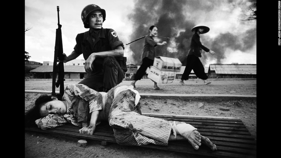 "Legendary Welsh war photographer Philip Jones Griffiths captured the battle for Saigon in 1968. U.S. policy in Vietnam was based on the premise that peasants driven into the towns and cities by the carpet-bombing of the countryside would be safe. Furthermore, removed from their traditional value system, they could be prepared for imposition of consumerism. This ""restructuring"" of society suffered a setback when, in 1968, death rained down on the urban enclaves. In 1971 Griffiths published ""Vietnam Inc."" and it became one of the most sought after photography books."