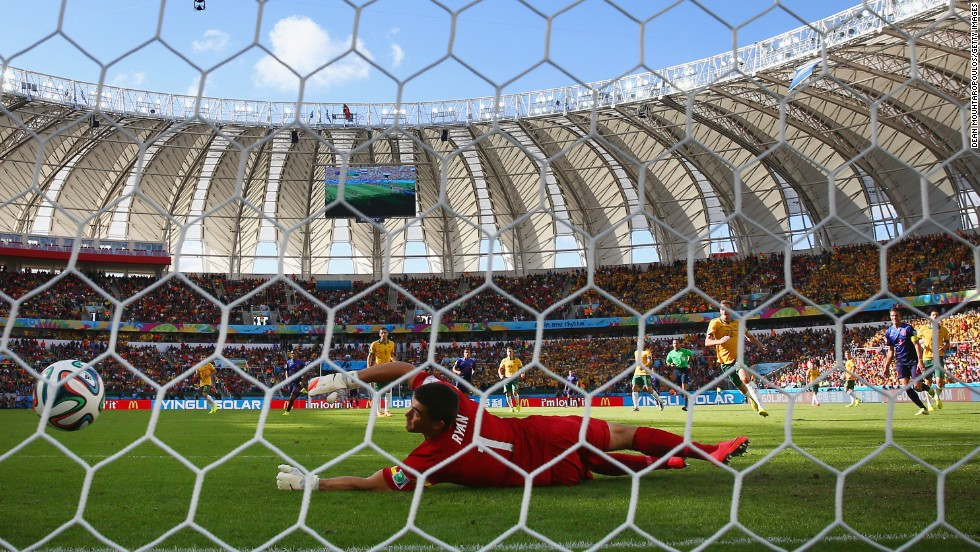Australian goalkeeper Mathew Ryan can't reach a shot by Memphis Depay on June 18. Depay's second-half goal gave the Netherlands a 3-2 victory in Porto Alegre, Brazil.