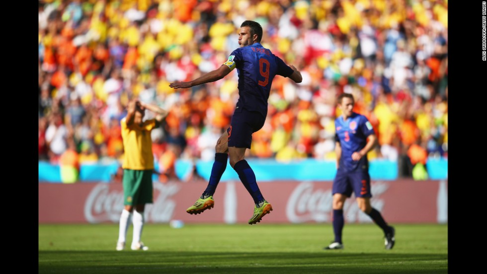 Van Persie celebrates after scoring his team's second goal and tying the game at 2-2. It was his third goal of the tournament.