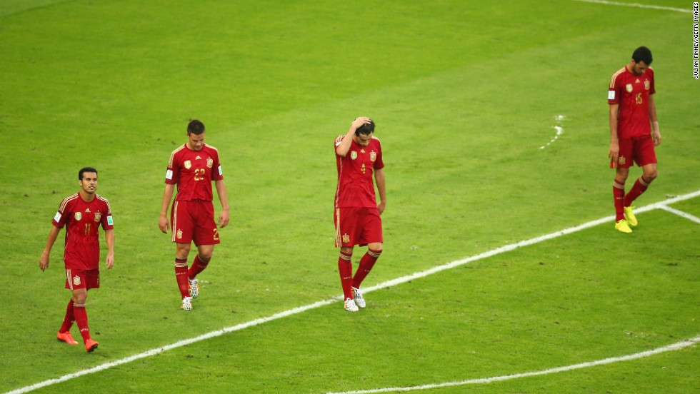 From left, Spanish players Pedro, Cesar Azpilicueta, Javi Martinez and Sergio Ramos react after Chile scored to take a 2-0 lead.