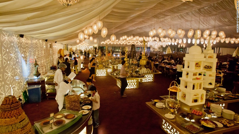 The white, billowy-walled Asateer Tent at the Atlantis Palm Jumeirah features a fountain from which sesame paste flows.