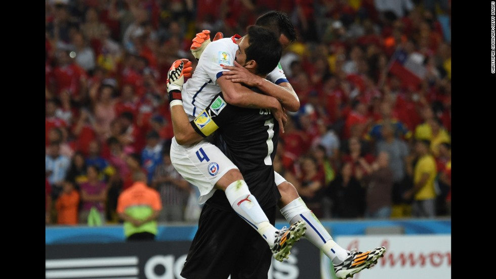Chilean defender Mauricio Isla, left, hugs goalkeeper Claudio Bravo after the match.