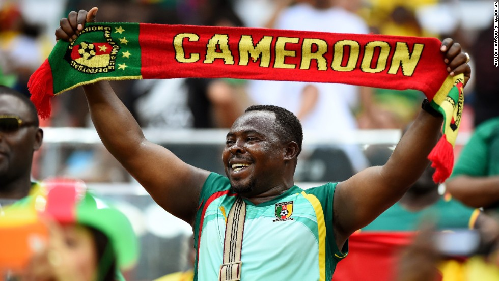 A Cameroon fan shows his support before the game.