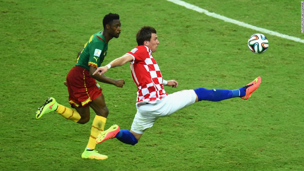 Mario Mandzukic of Croatia competes for the ball with Nicolas N'Koulou of Cameroon.