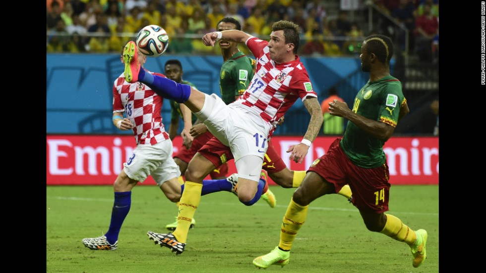 Croatia's Mario Mandzukic vies for the ball.