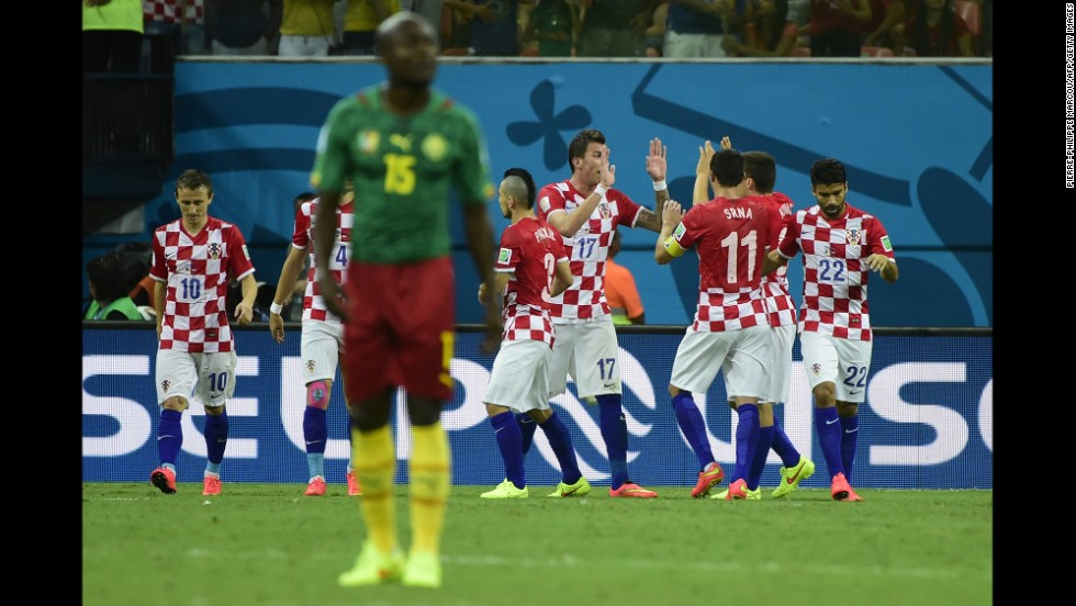 Croatia's team celebrates Mario Mandzukic's second goal.