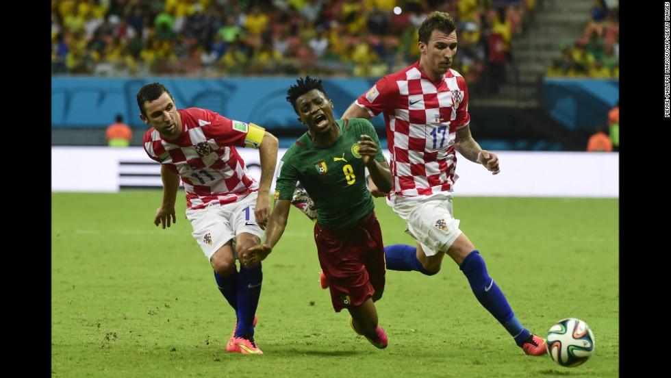 Croatia's Darijo Srna, left, and Mario Mandzukic tackle Cameroon's Benjamin Moukandjo.