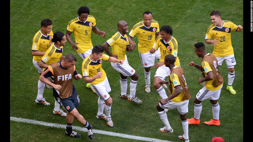 Colombia players dance after the first goal of the game, which was scored by James Rodriguez (No. 10) on a header.