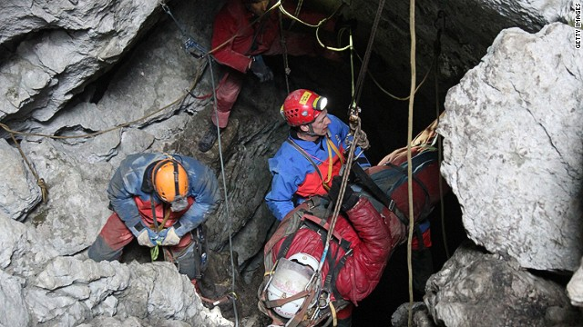 MARKTSCHELLENBERG, GERMANY - JUNE 19: In this handout photo provided by the Bavarian Mountain Patrol (Bergwacht Bayern), rescue workers bring injured spelunker Johann Westhauser to the surface from the Riesending vertical cave during the final phase of his rescue on June 19, 2014 near Marktschellenberg, Germany. Westhauser received a severe head injury when he was struck by rocks in the cave on June 8, 1,000 meters below the surface, and since then over 700 rescue workers from Germany, Italy, Switzerland, Austria and Croatia have been working around the clock in an arduous effort to save him. Westhauser was among explorers who first discovered the cave, which is over 20 kilometers long, in 1995. (Photo by Bergwacht Bayern via Getty Images) *** BESTPIX ***