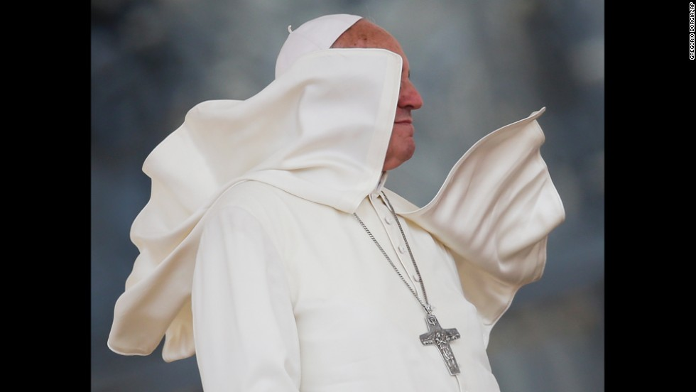 A gust of wind catches Pope Francis' mantle Saturday, June 14, at St. Peter's Square in the Vatican.