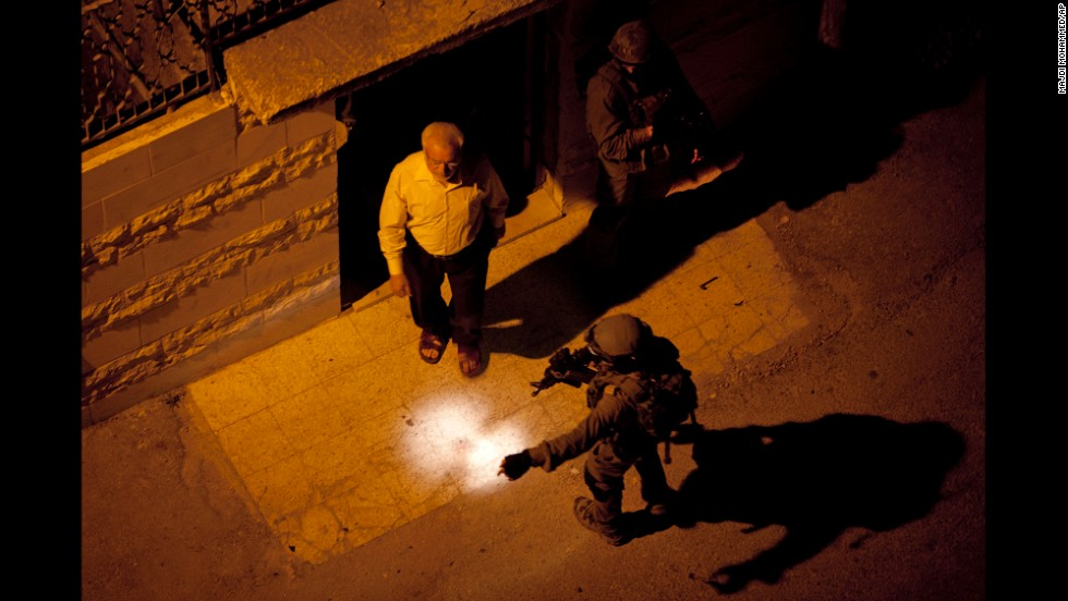 "Israeli soldiers arrest Abdel Aziz Dweik, speaker of the long-defunct Palestinian parliament and a senior Hamas figure, at his home in Hebron, West Bank, on Monday, June 16. Israeli soldiers <a href=""http://www.cnn.com/2014/06/16/world/meast/west-bank-jewish-teens-missing/index.html"">detained more than 150 Palestinian suspects</a> in the search for three teenagers who Israel says were kidnapped, the military announced. The Palestinian Ministry of Information said in a written statement that the arrests come under ""flimsy pretexts"" as a ""continuation of the aggression"" on Palestinians. <a href=""http://www.cnn.com/2014/06/13/world/gallery/week-in-photos-0612/index.html"">See last week in 29 photos</a>"