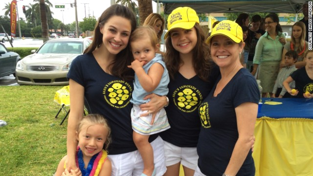 It's a family affair!  Madison's mom, sister and niece lend a hand at an event for Alex's Lemonade Stand in Fort Lauderdale, Florida.