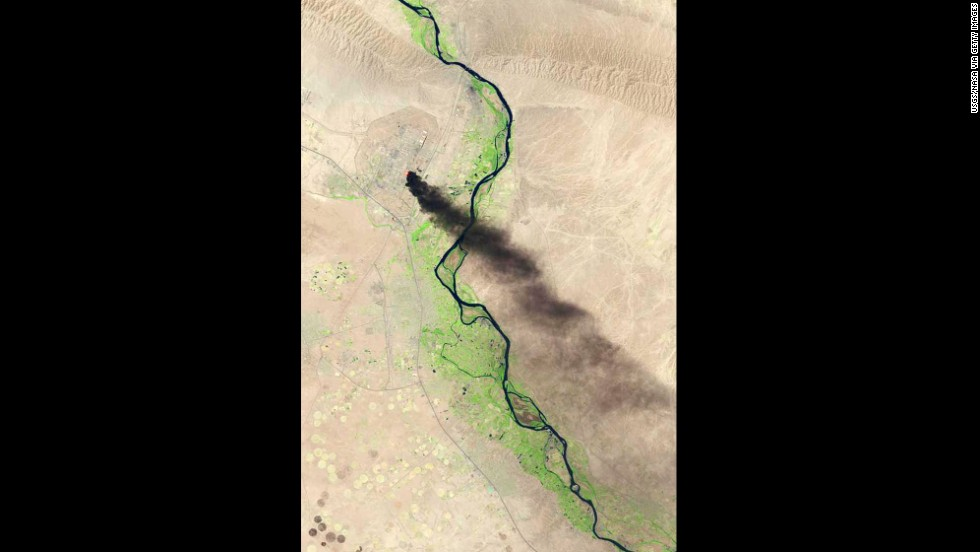 A U.S. Geological Survey photo taken on Wednesday, June 18, shows smoke billowing from the the Baiji North refinery complex in Baiji, Iraq. An attack on the refinery, located about 130 miles north of Baghdad, started late Tuesday night and continued into Wednesday morning as Islamic militants moved closer to Baghdad after taking control of several northern Iraqi cities.