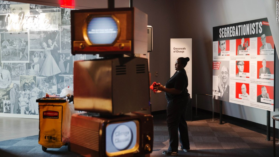 An employee cleans an exhibit on segregation.