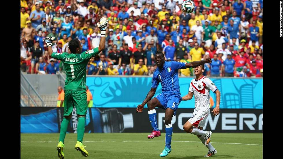 Balotelli, center, shoots wide past Costa Rican goalkeeper Keylor Navas.