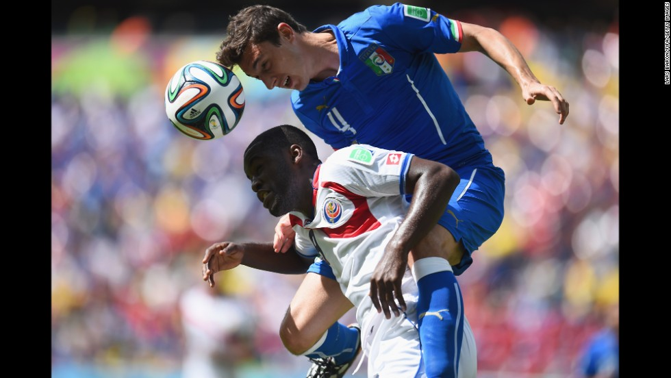 Campbell and Matteo Darmian of Italy compete for a header.