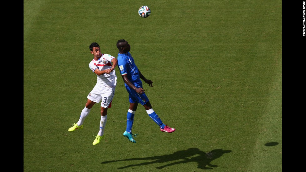 Balotelli and Gonzalez go up for a header in the first half.