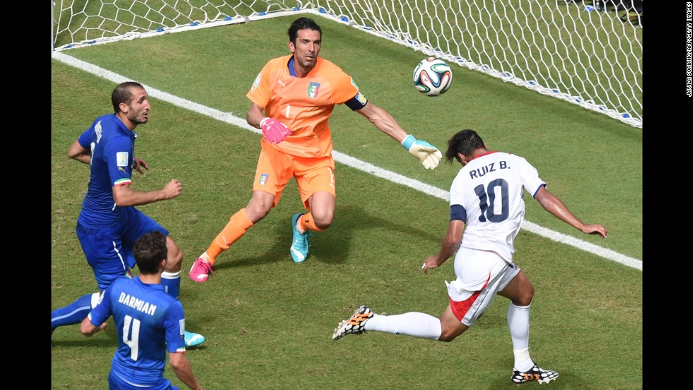 Costa Rican forward Bryan Ruiz heads the ball past Italian goalkeeper Gianluigi Buffon during the first half of a World Cup match Friday, June 20, in Recife, Brazil. Costa Rica held on to win 1-0 and clinch a spot in the next round of the tournament.