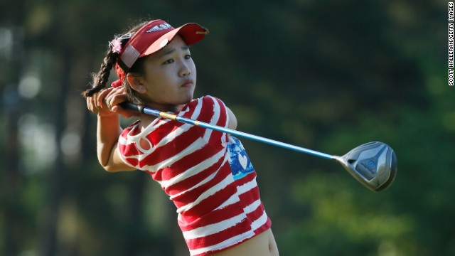 Caption:PINEHURST, NC - JUNE 19: Eleven year-old Amateur Lucy Li of the United States watches her tee shot on the 13th hole during the first round of the 69th U.S. Women's Open at Pinehurst Resort & Country Club, Course No. 2 on June 19, 2014 in Pinehurst, North Carolina. (Photo by Scott Halleran/Getty Images)