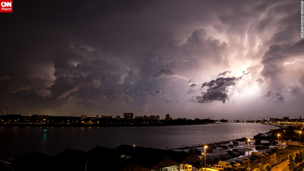 "In Antwerp, Belgium, <a href=""http://ireport.cnn.com/docs/DOC-1145336"">Zachary Koulermos</a> was woken up by a hailstorm in June. After the hail subsided, the rain brought an ""amazing lightning storm,"" he said. He grabbed his camera and tripod as the clouds retreated."