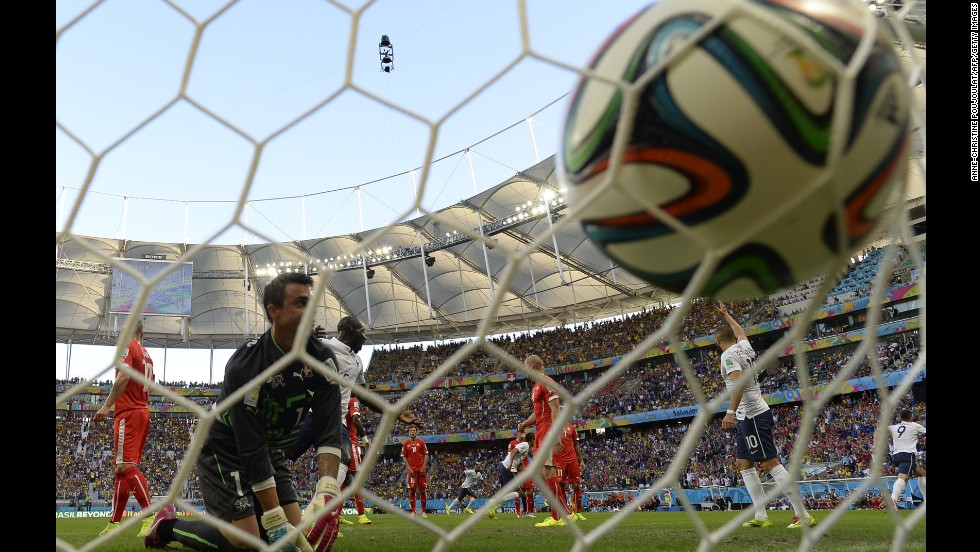 Benaglio kneels near the net after French forward Olivier Giroud, far right, headed in a goal to open the scoring.