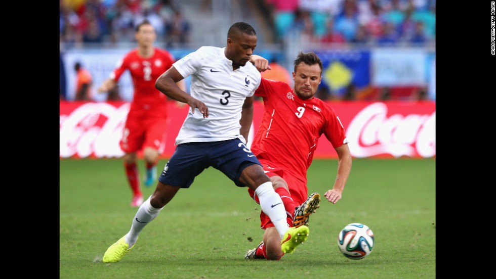 Evra and Switerland's Haris Seferovic battle for the ball.