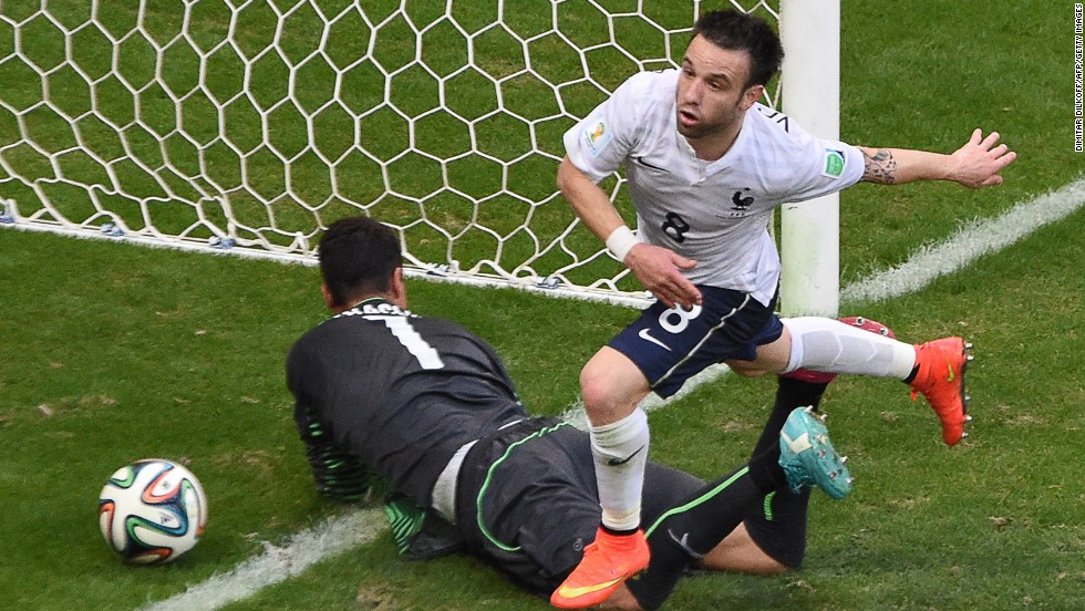 France's Mathieu Valbuena runs past Benaglio after giving his team a 3-0 lead in the first half.