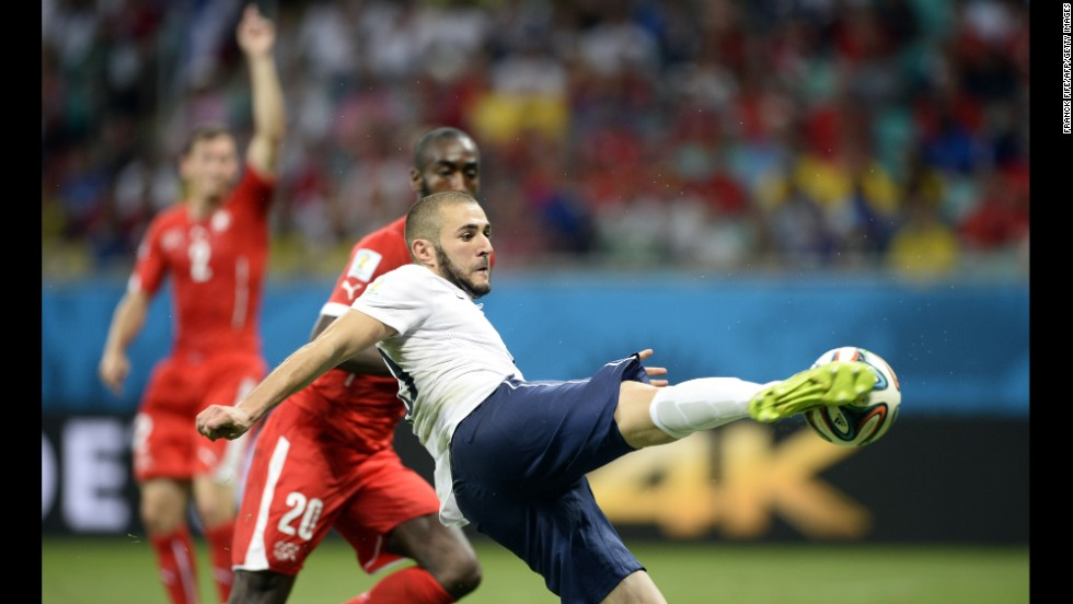 French forward Karim Benzema scores his team's fourth goal.