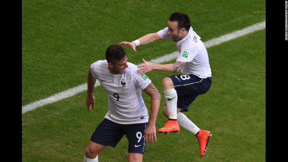 France midfielder Mathieu Valbuena, right, jumps on Giroud's back after Giroud assisted on his first-half goal.