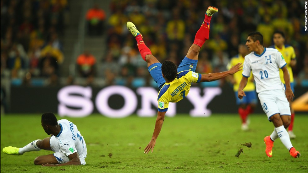 Jefferson Montero of Ecuador falls after a challenge by Maynor Figueroa of Honduras.