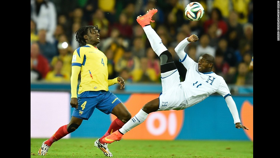 Ecuador defender Juan Carlos Paredes, left, vies with Honduras forward Jerry Bengtson.