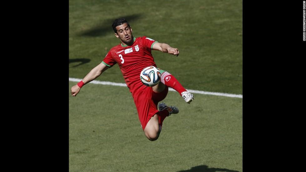 Iran midfielder Ehsan Hajsafi plays the ball.