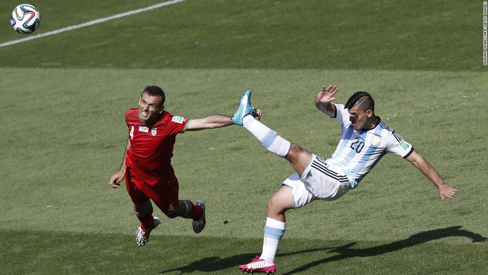 Iran defender Jalal Hosseini, left, and Argentina forward Sergio Aguero vie for the ball.