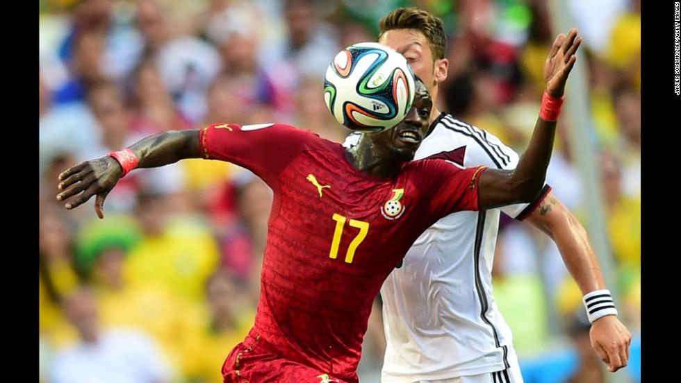 Ghana midfielder Mohammed Rabiu, left, vies with Germany midfielder Mesut Ozil.