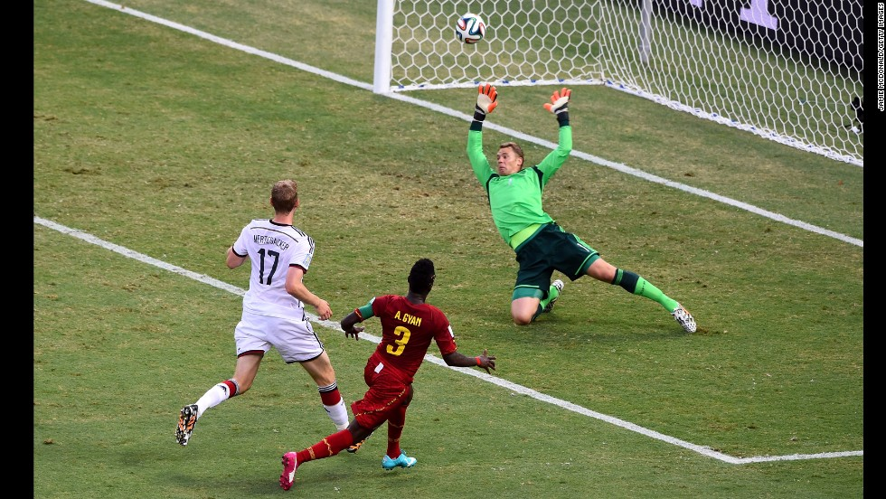 Asamoah Gyan of Ghana scores his team's second goal past Manuel Neuer, but Germany battled back to earn a 2-2 draw.