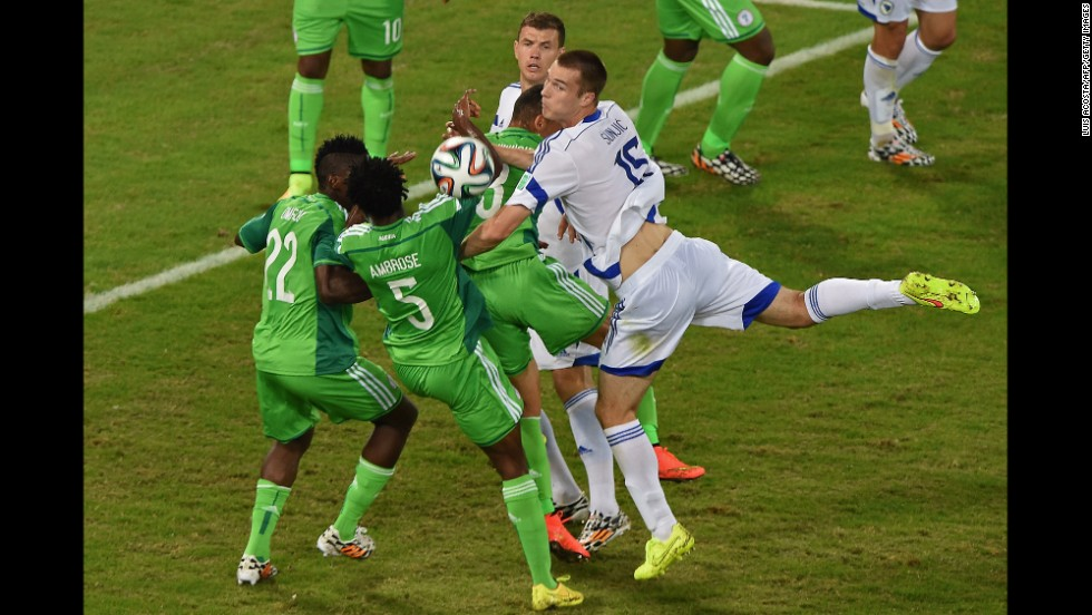 Bosnia defender Toni Sunjic, right, fights for the ball with Nigeria defender Kenneth Omeruo, left, Nigeria defender Efe Ambrose and Nigeria forward Peter Odemwingie, center.