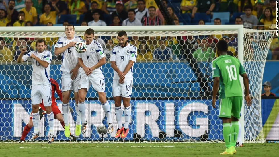 From left to right, Bosnia-Herzegovina midfielder Senad Lulic, defender Toni Sunjic, forward Edin Dzeko and midfielder Haris Medunjanin jump to block a free kick by Nigeria midfielder John Obi Mikel`.