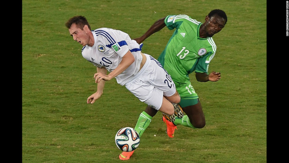 Nigeria defender Juwon Oshaniwa, right, challenges Bosnia-Herzegovina midfielder Izet Hajrovic.