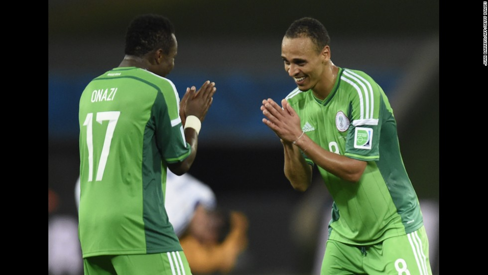 Nigeria midfielder Ogenyi Onazi, left, and forward Peter Odemwingie celebrate their win over Bosnia-Herzegovina in a World Cup match at Pantanal Arena in Cuiaba, Brazil, on Saturday, June 21. Nigeria won 1-0 and Bosnia was eliminated.