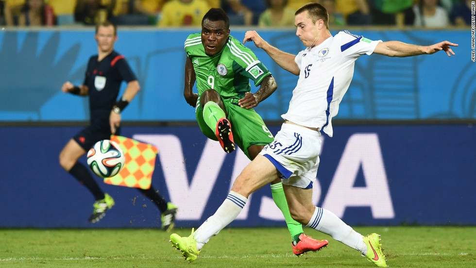 Bosnia defender Toni Sunjic challenges Nigeria forward Emmanuel Emenike.