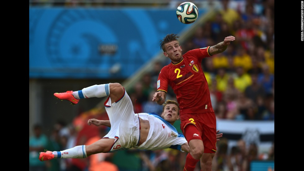 Belgian defender Toby Alderweireld heads the ball past Russian forward Alexander Kokorin.