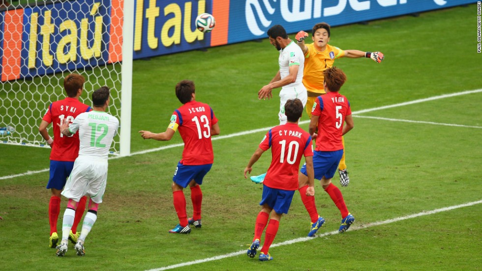 Algeria's Rafik Halliche scores the second goal against South Korea on a header.