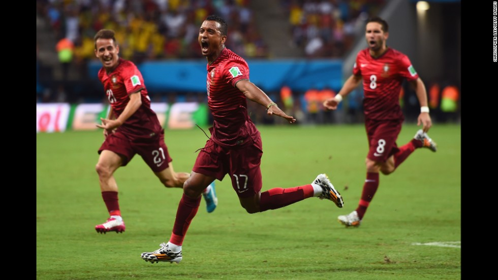 Portugal's Nani, center, celebrates scoring a goal against the United States. He scored on a cross about 6 yards out from the goal.
