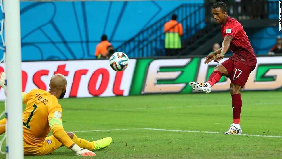 Nani of Portugal scores his team's first goal past U.S. goalkeeper Tim Howard. Portugal took a 1-0 lead in the fifth minute of the match.