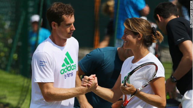Murray talks with Mauresmo during a practice session for Wimbledon in 2014.