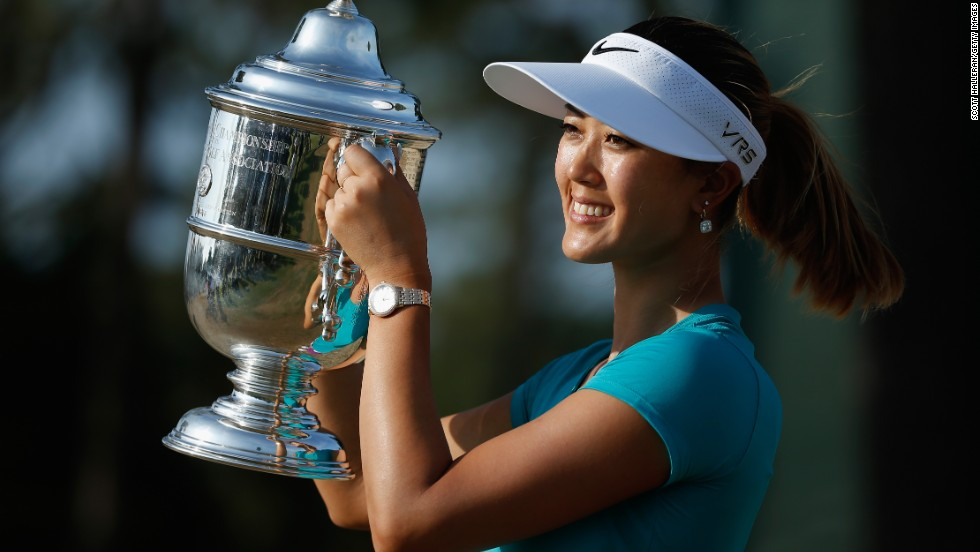 Michelle Wie of the United States poses after her two-stroke victory at the 69th U.S. Women's Open at Pinehurst Resort & Country Club.