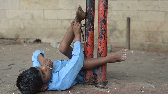Disabled boy tied to bus stop