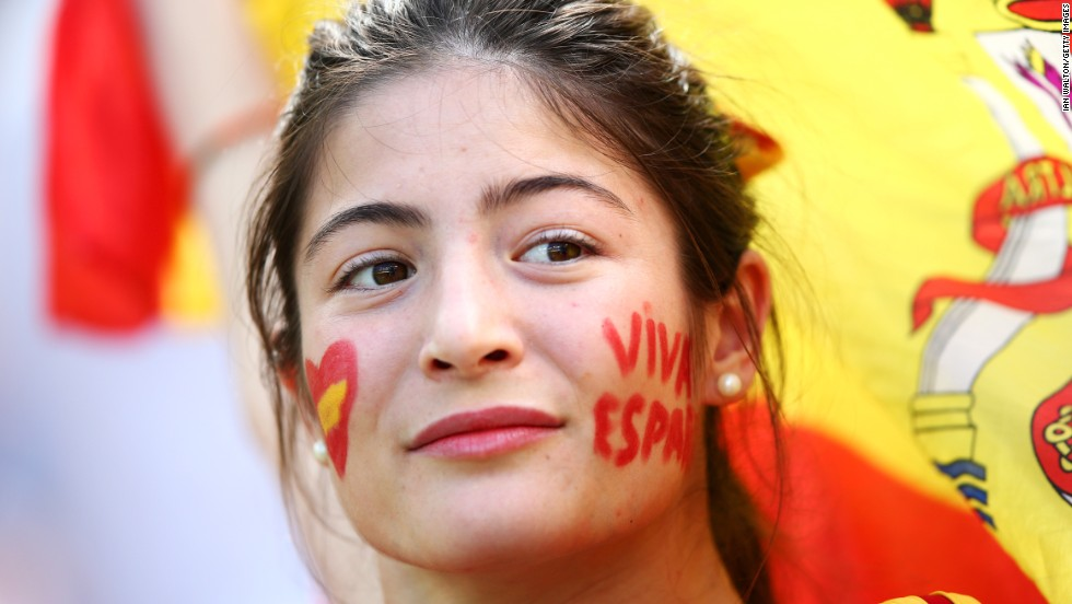 "A Spain fan looks on prior to the match against Australia. <a href=""http://www.cnn.com/2014/06/22/football/gallery/world-cup-0622/index.html"">See the best World Cup photos from June 22.</a>"